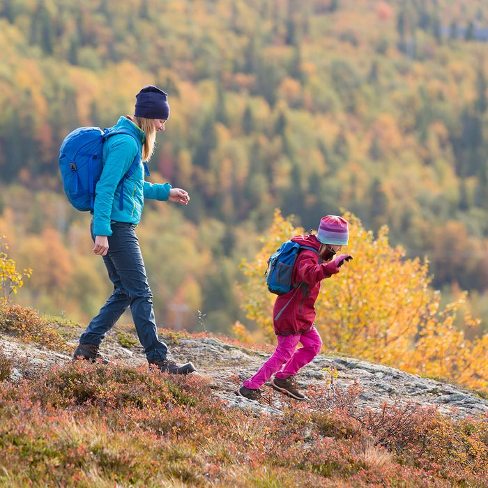 Mother with daughter hiking
