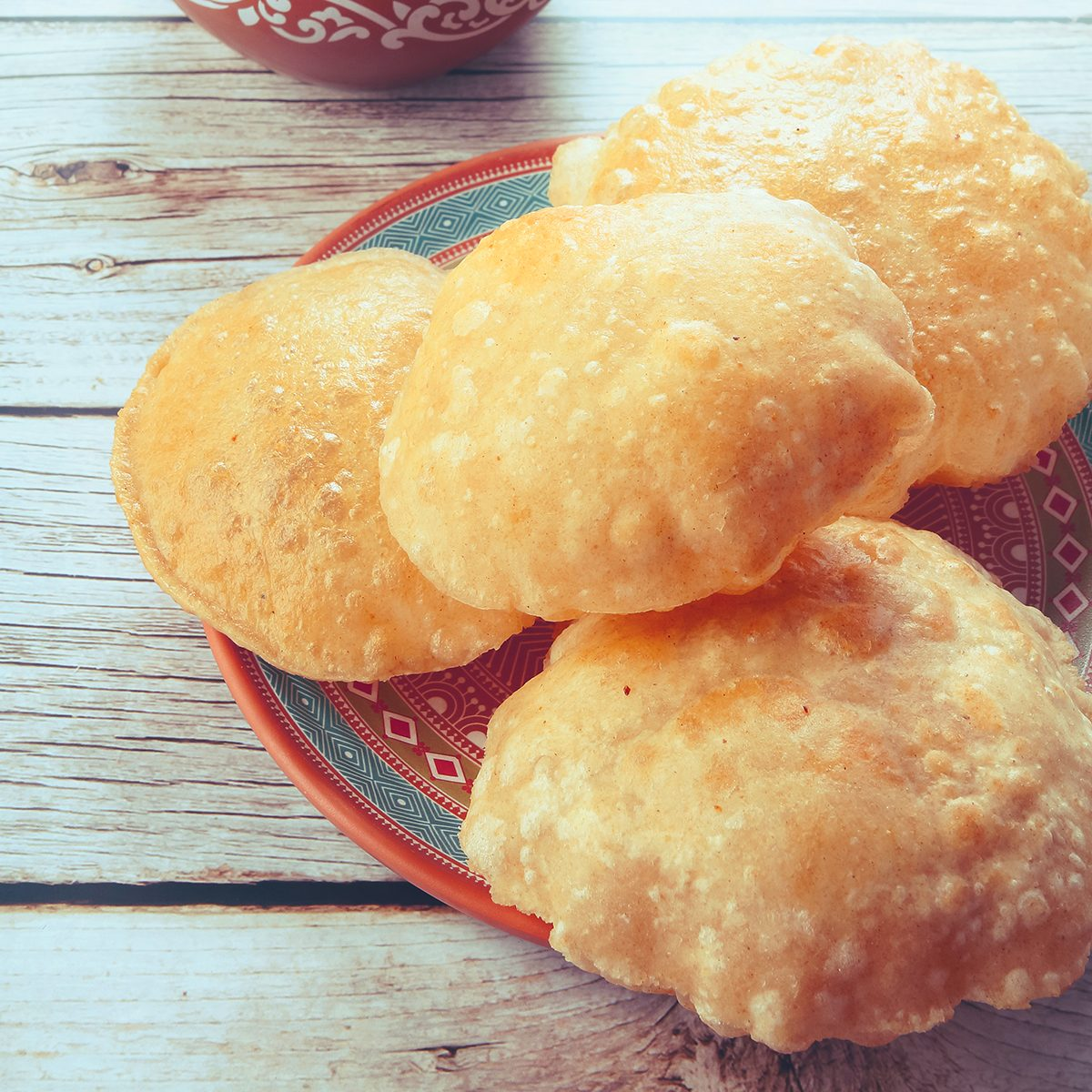 South Indian traditional food Poori or puri with country chicken curry