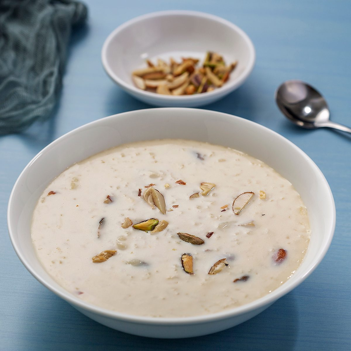 Kheer or Payasam is a type of pudding from the Indian subcontinent, made by boiling milk and sugar and is flavoured with desiccated coconut, cardamom, raisins, saffron, cashews, pistachios, almonds or other dry fruits and nuts.