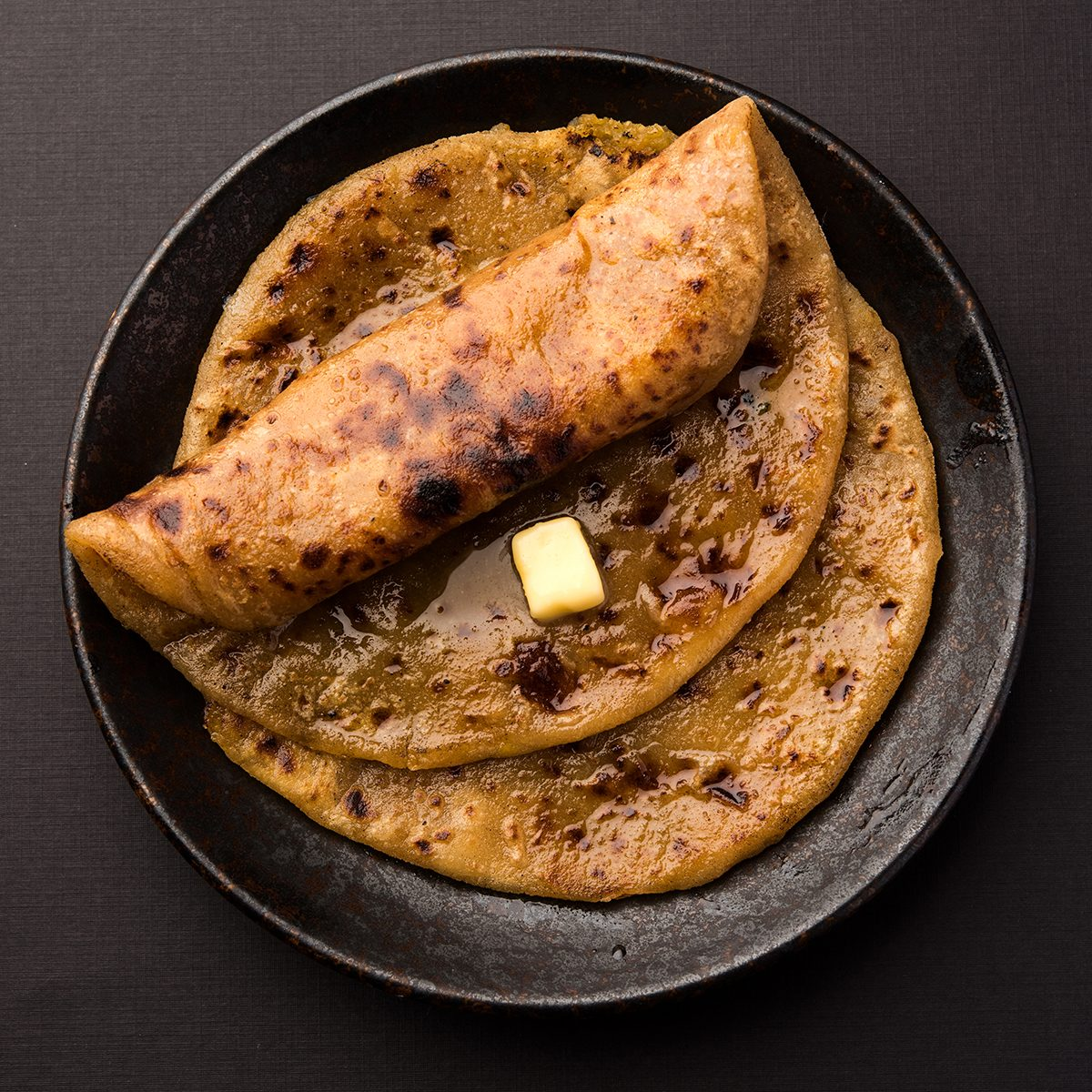 Puran Poli / Puranpoli / Holige / Obbattu - Indian sweet flatbread, selective focus