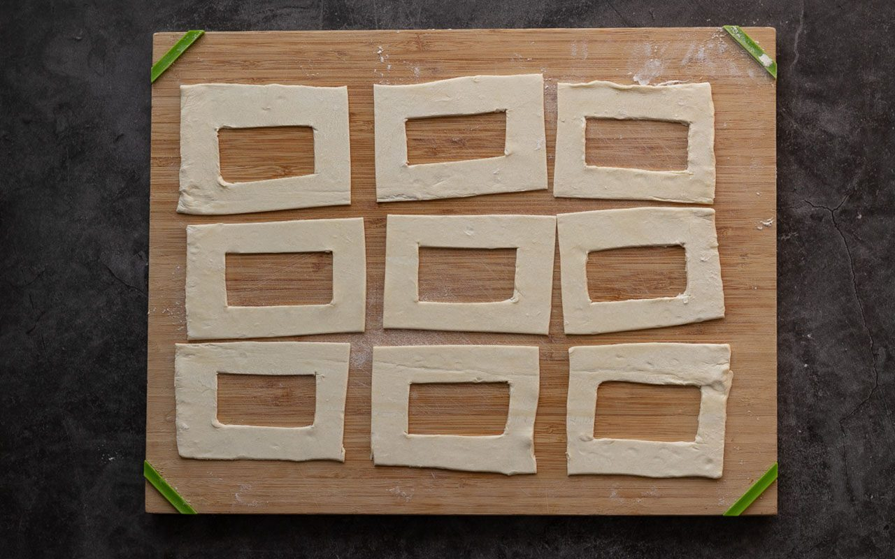 Rectangles of puff pastry dough with rectangular cutouts in the centers. starbucks cheese danish copycat
