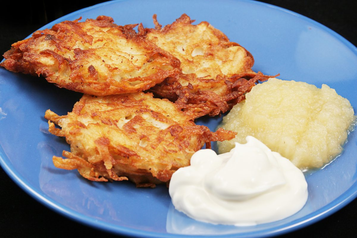 Hanukkah latkes served with apple sauce and sour cream.