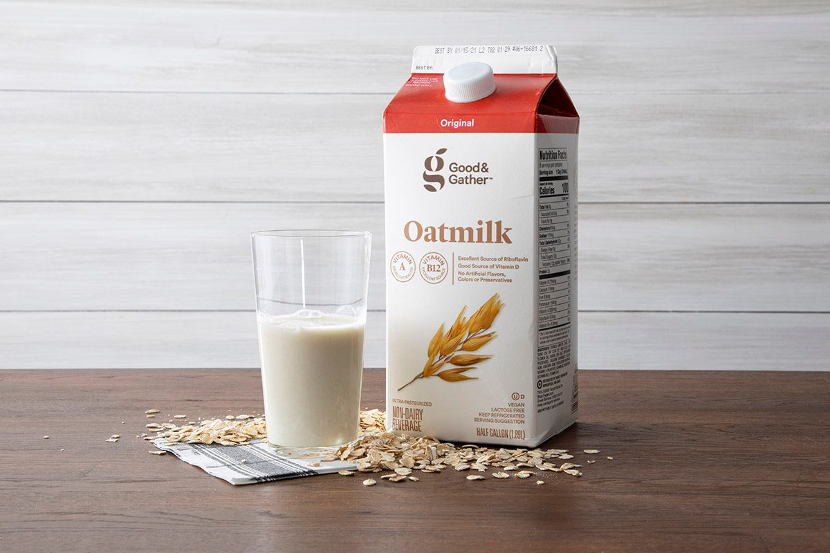 Good & Gather Oat Milk On Counter With Glass And Oats.