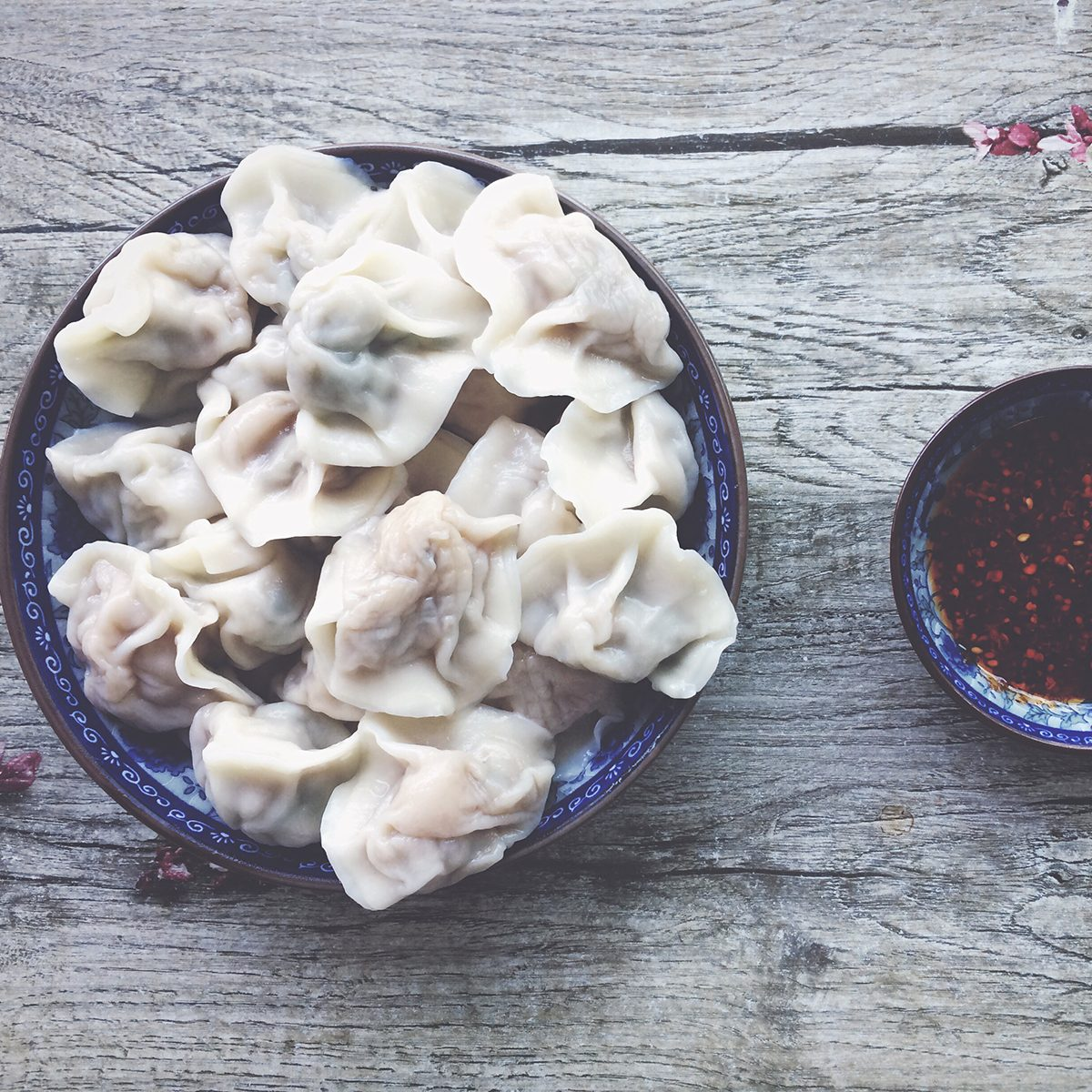 indian main dishes Dumpling And Chili Oil Served In Bowls On Wooden Table