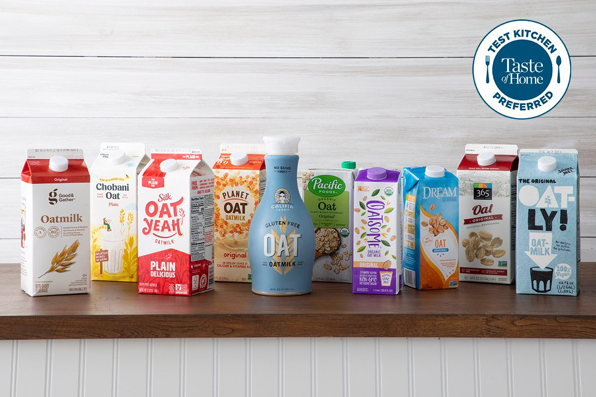 Oat Milks On Counter In Containers