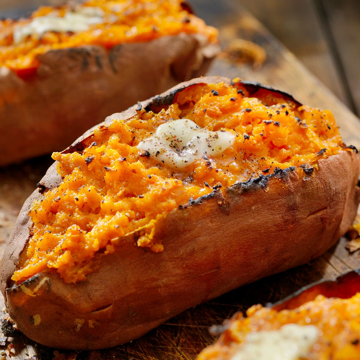 Twice Baked, Stuffed Sweet Potatoes with Melting Butter and Cracked Pepper