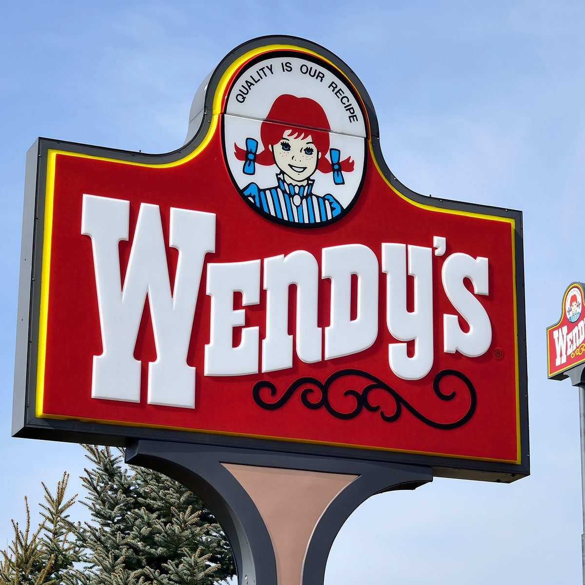 """Clio, Michigan, USA - March 7, 2012: The Wendy's location in Clio, Michigan. Founded in 1969 by Dave Thomas, Wendy's is a chain of fast food restaurants with over 6,600 locations in the US and abroad."""