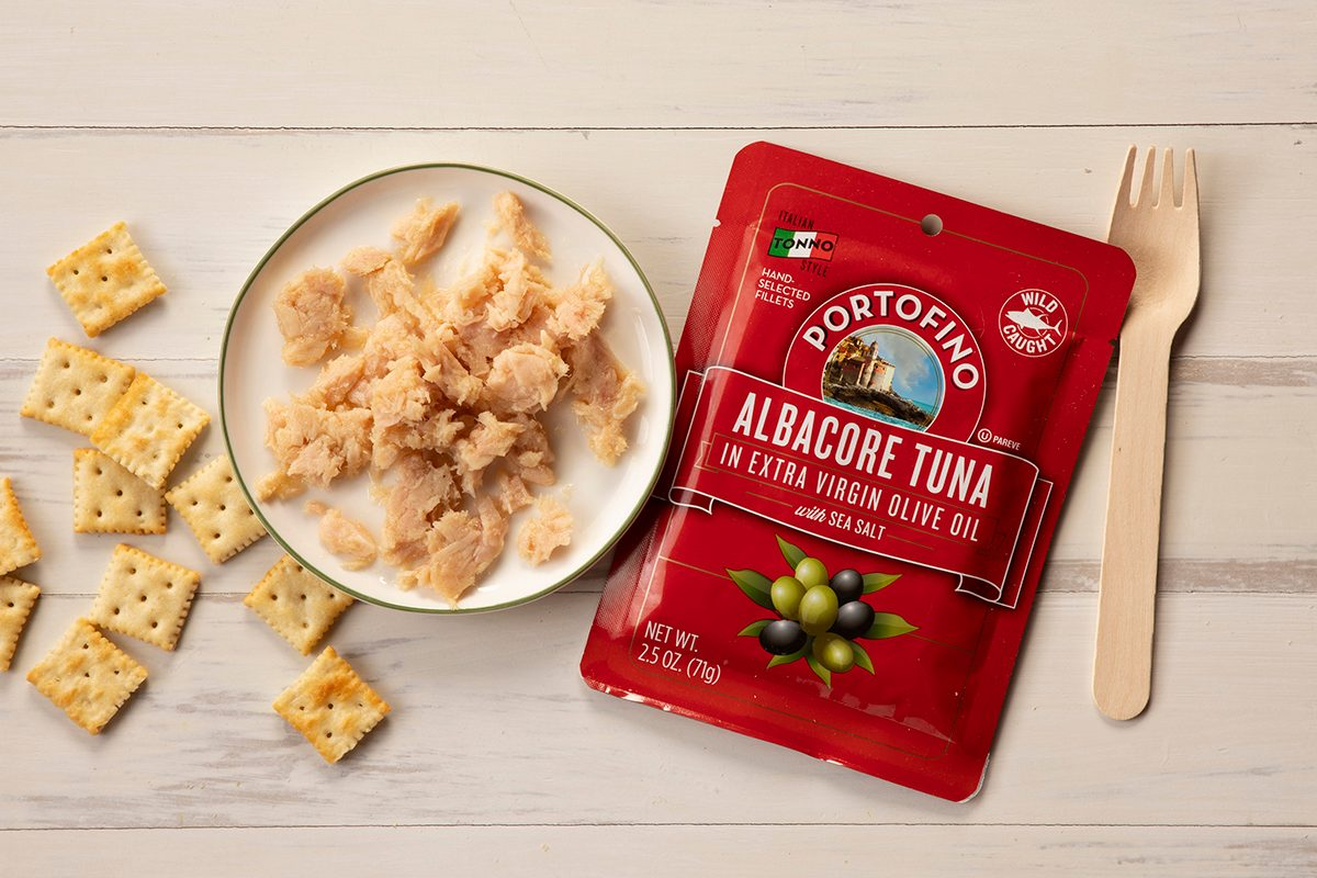 Overhead Shot Of Portofino Tuna In Package And On Plate With Fork And Crackers