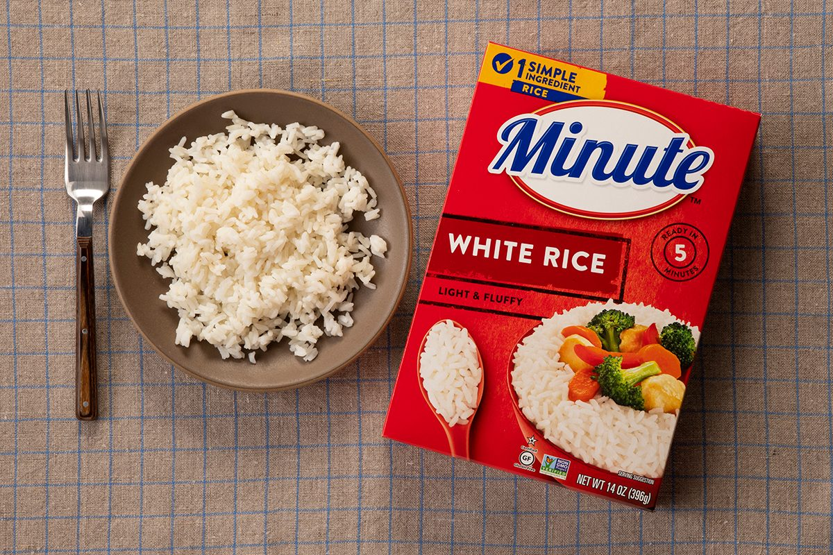 Overhead Shot Of Minute White Rice In Package And On Plate.