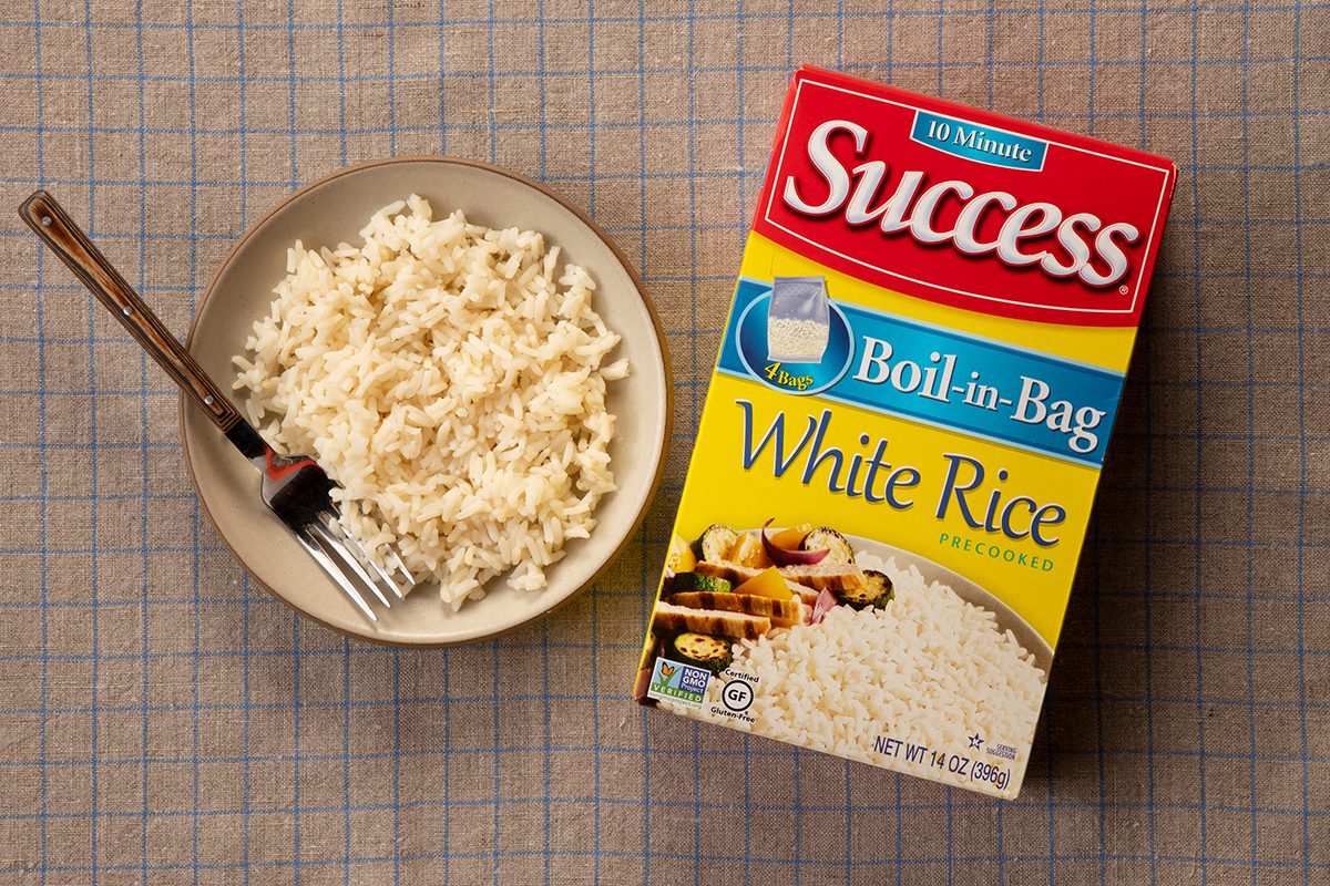 Overhead Shot Of Success White Rice In Package And On Plate