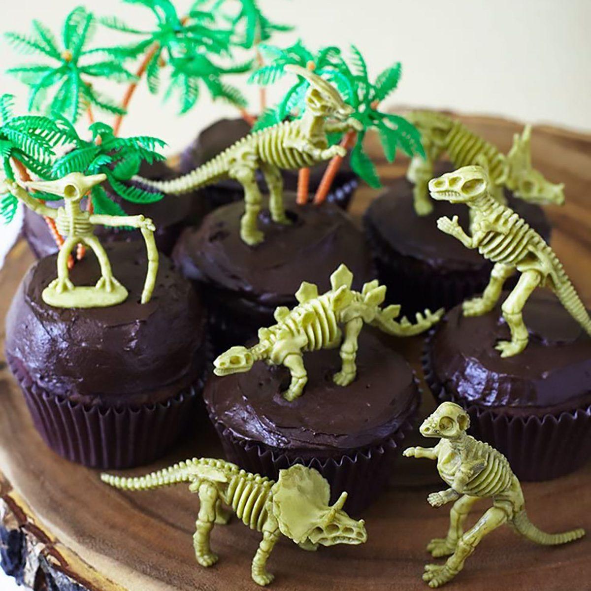 "Cakegirls (24) Dinosaur Bones Cupcake Toppers Kit - (12) 3 1/2"" Dinosaur Skeletons Fossils Assorted T-Rex, Triceratops, Stegosaurus (12) 3"" Palm Trees (30) Brown Grease Proof Cupcake Liners"