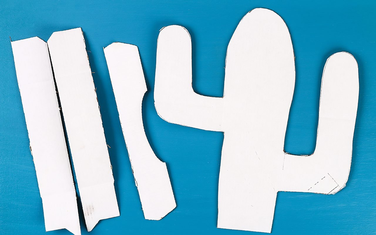 Diy cinco de mayo Mexican Pinata Cactus made cardboard and crepe paper your own hands on a blue background. Gift idea, decor, game cinco de mayo. Step by step. Top view. Process kid children craft.