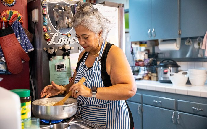 prediabetes foods to avoid Hispanic Woman Making Dinner In Kitchen